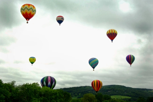 colorful balloons brighten cloudy day