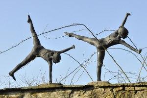 cartwheeling statues